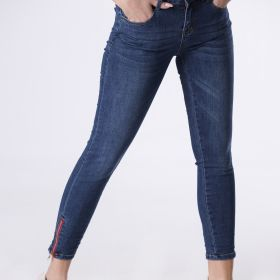 dopasowane jeansy z suwakami przy kostkach
